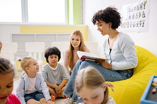 Teacher in Classs room with young children
